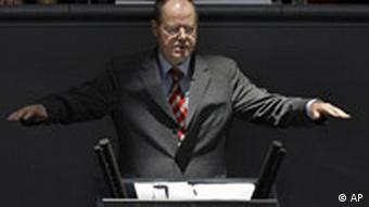German Finance Minister Peer Steinbrueck delivers a speech during a debate at the parliament