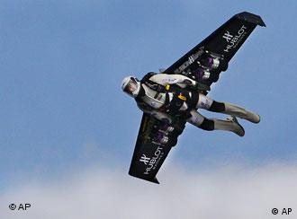 Yves Rossy flying with his homemade jet-propelled wing.