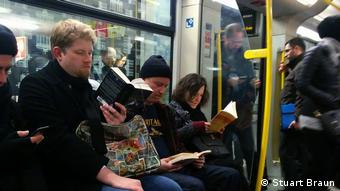 People reading books on the tram