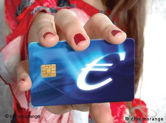 Hand holding a blue card with a euro symbol on it