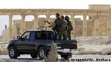 Members of the Syrian army patrol the ancient Syrian city of Palmyra on May 6, 2016, during a patriotic celebration put on by the Syrian regime at the UNESCO world heritage site, with flag-waving and military music in a place where just last year jihadists carried out mass executions. Syrian troops backed by Russian air strikes and special forces on the ground recaptured the UNESCO world heritage site from Islamic State group fighters in March. / AFP / LOUAI BESHARA (Photo credit should read LOUAI BESHARA/AFP/Getty Images)