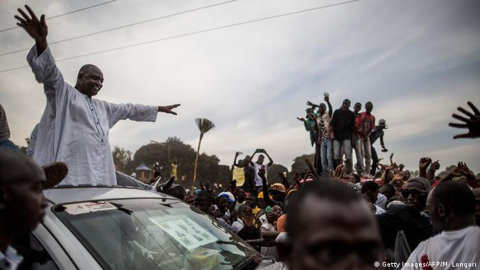 Gambia's President Adama Barrow greeting the crowds from a car during his electoral campaign in November 2017.