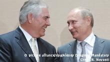 2011*** Russia's Prime Minister Vladimir Putin (R) speaks with Exxon Mobile CEO and Chairman Rex Tillerson (L) during a ceremony of signing of the Rosneft-ExxonMobil Strategic Cooperation Agreement in the Black Sea resort of Sochi, Russia 30 August 2011. The agreement includes approximately US $3.2 billion to be spent funding exploration of East Prinovozemelskiy Blocks 1, 2 and 3 in the Kara Sea and the Tuapse License Block in the Black Sea. Rosneft equity interest in both joint ventures will be 66.7 per cent, while ExxonMobil will hold 33.3 per cent. EPA/ALEXEY DRUGINYN MANDATORY CREDIT/RIA NOVOSTI /*** NO SALES NO ARCHIVES NOT FOR USE AFTER 30 SEPTEMBER 2011 *** |