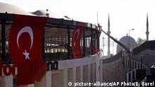 Dec. 11, 2016 A firefighter works on the roof of the Besiktas football club stadium Vodafone Arena decorated with Turkish flags in Istanbul, Sunday, Dec. 11, 2016 following the late Saturday explosion. Turkey declared a national day of mourning Sunday after twin blasts in Istanbul killed dozens of people and wounded many others near a soccer stadium — the latest large-scale assault to traumatize a nation confronting an array of security threats. (AP Photo/Emrah Gurel) |