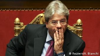 A pensive-looking Paolo Gentiloni seated on a gilded chair (Reuters/A. Bianchi)