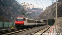 11 December 2016 epa05670378 A passenger train enters the south portal of the Gotthard rail tunnel, the longest tunnel in the world, between Erstfeld and Pollegio, in Pollegio, Switzerland, 11 December 2016. The construction of the 57 kilometer long tunnel began in 1999, the breakthrough was in 2010. After the official opening on June 1, the commercial operation starts on 11 December 2016. EPA/SAMUEL GOLAY  