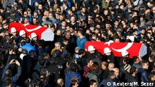 11.12.2016*** People carry the flag-draped coffins of police officers killed in Saturday's blasts in Istanbul, Turkey, December 11, 2016. REUTERS/Murad Sezer