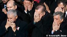 11.12.2016*** Turkish Prime Minister Binali Yildirim, President Tayyip Erdogan and Former President Abdullah Gul pray during a ceremony for police officers killed in Saturday's blasts in Istanbul, Turkey, December 11, 2016. REUTERS/Murad Sezer