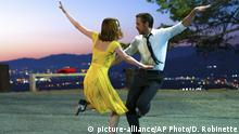 """This image released by Lionsgate shows Ryan Gosling, right, and Emma Stone in a scene from, La La Land. The 74th annual Golden Globe nominations will be streamed live online, beginning at 8:10 a.m. EST, Monday, Dec. 12. Among the films expected to take in a number of nods are Damien Chazelle's nostalgic Los Angeles musical """"La La Land,"""" Barry Jenkins' lyrical coming-of-age tale """"Moonlight,"""" and Kenneth Lonergan's New England drama """"Manchester by the Sea."""" (Dale Robinette/Lionsgate via AP) 