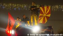 11.12.2016 **** Supporters of opposition party Social Democratic SDSM celebrate in front of the government building after parliamentary elections in Skopje on December 11, 2016. Macedonians began voting in an early general election in a bid to end a deep political crisis that has roiled the small Balkan country for nearly two years. / AFP / Robert ATANASOVSKI (Photo credit should read ROBERT ATANASOVSKI/AFP/Getty Images)