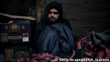 08.12.2016 *** TO GO WITH AFP STORY BY NICOLAS GAUDICHET Mohamed Darwich, a 17-year old migrant from Afghanistan, poses in a makeshift shelter at an abandoned warehouse in Belgrade on December 8, 2016. About 1,000 migrants are sleeping rough in downtown Belgrade, as the Serbian winter is becoming harsh, according to the United Nations refugee agency (UNHCR). According to the latest figures, more than 6,000 migrants are stranded in Serbia. / AFP / ANDREJ ISAKOVIC (Photo credit should read ANDREJ ISAKOVIC/AFP/Getty Images)