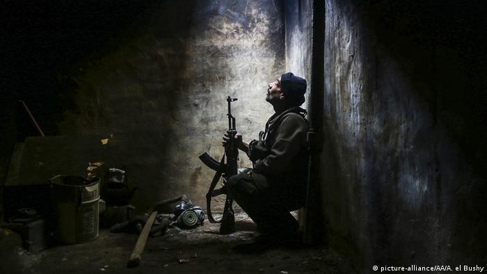 A member of Feylek er-Rahman group, part of the Syrian opposition, is seen as they clash with Assad Regime forces