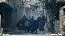December 12, 2016 People carry belongings as they flee deeper into the remaining rebel-held areas of Aleppo, Syria December 12, 2016. REUTERS/Abdalrhman Ismail
