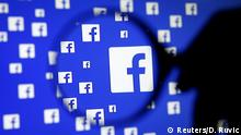 A man poses with a magnifier in front of a Facebook logo on display in this illustration taken in Sarajevo, Bosnia and Herzegovina, December 16, 2015. REUTERS/Dado Ruvic/Illustration/File Photo GLOBAL BUSINESS WEEK AHEAD PACKAGE - SEARCH BUSINESS WEEK AHEAD JULY 25 FOR ALL IMAGES