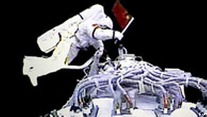 In this video grab taken at the Beijing Space Command and Control Center released by China's Xinhua News Agency, Saturday, Sept. 27, 2008, Chinese astronaut Zhai Zhigang walks outside the orbit module of the Shenzhou-7 spacecraft for a spacewalk. (AP Photo/Xinhua)