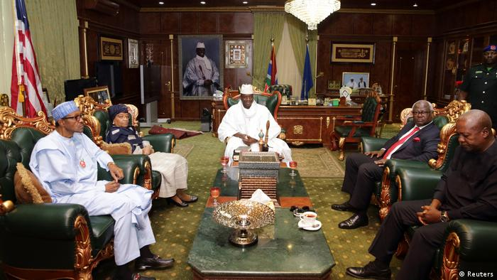 Gambia's President Yahya Jammeh receives a delegation of West African leaders including President John Mahama of Ghana and Nigeria's Muhammadu Buhari during a meeting on election crisis in Banjul