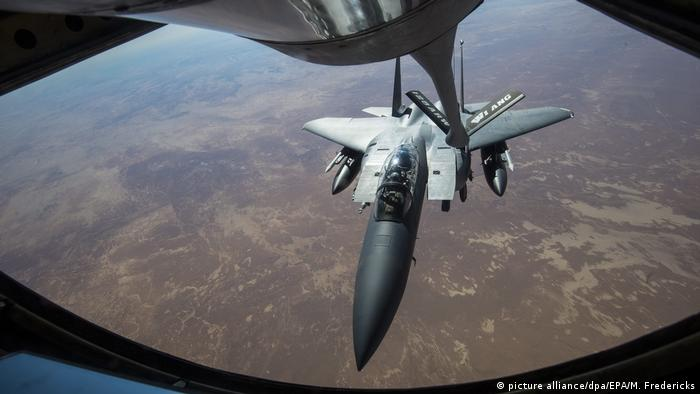 A handout picture obtained from the US Department of Defense on 10 December 2016 shows a US Air Force F-15 Strike Eagle jet receiving fuel from a KC-135 Stratotanker