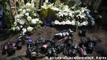 Mexico City, Mexico. 3rd August 2015 -- Fellow photojournalists lay their cameras next to the grave of Ruben Epinosa Becerril, a photojournalist who was found shot to death in a Mexico City apartment, as he is laid to rest. -- Family and friends were joined by photographers and journalists as Ruben Epinosa Becerril, a photojournalist murdered in a Mexico City apartment was laid to rest. |