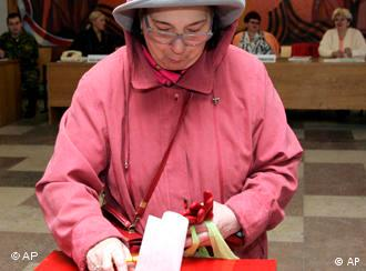 A Belarusian woman casts her ballot paper at a polling station during parliamentary elections in Minsk, Belarus, Sunday, Sept. 28, 2008.