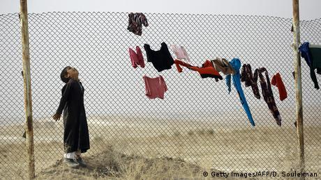An Iraqi refugee who fled Mosul