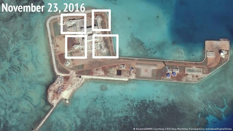 China installs weapons on disputed Spratly islands - report