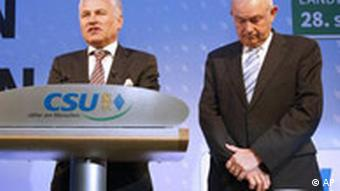 Bavarian State Governor Guenther Beckstein, right, from the German Christian Social Union (CSU), and Erwin Huber, chairman of the CSU, left