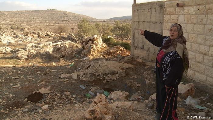Mariam Hammad points towards her ancestral property in Amona