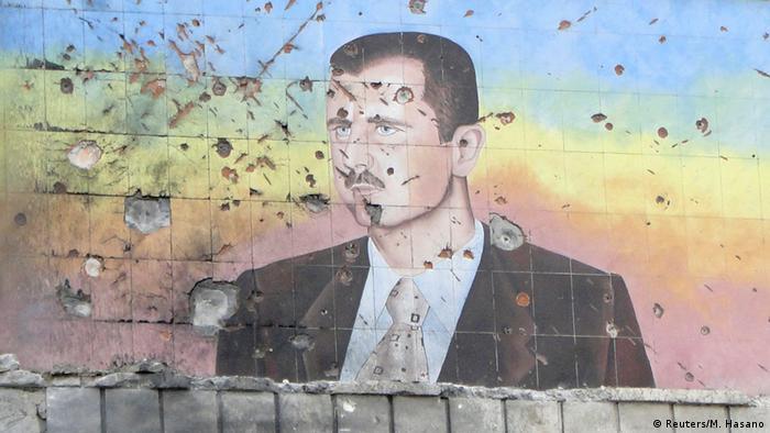 Портрет Башара Асада на стене дома в Алеппо