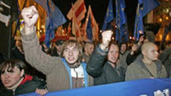 Opposition activists protest against the parliamentary elections shortly after polling closed, in the Belarusian capital Minsk, Sunday, Sept. 28, 2008.