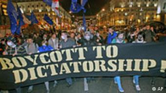 Protestors march with sign Boycott to dictatorship
