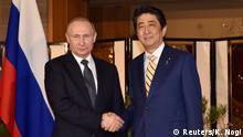 15.12.2016 Russian President Vladimir Putin shakes hands with Japanese Prime Minister Shinzo Abe before their talks in Nagato, Yamaguchi prefecture on December 15, 2016. REUTERS/ Kazuhiro Nogi/Pool
