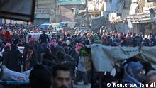 15.12.2016 *** People gather to be evacuated from al-Sukkari rebel-held sector of eastern Aleppo, Syria December 15, 2016. REUTERS/Abdalrhman Ismail TPX IMAGES OF THE DAY