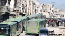 15.12.2016 *** People get on buses to be evacuated from al-Sukkari rebel-held sector of eastern Aleppo, Syria December 15, 2016. REUTERS/Abdalrhman Ismail
