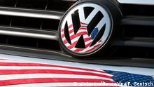 American flag reflected in a VW logo Foto: Friso Gentsch/dpa
