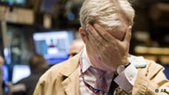 Stock trader holding his head