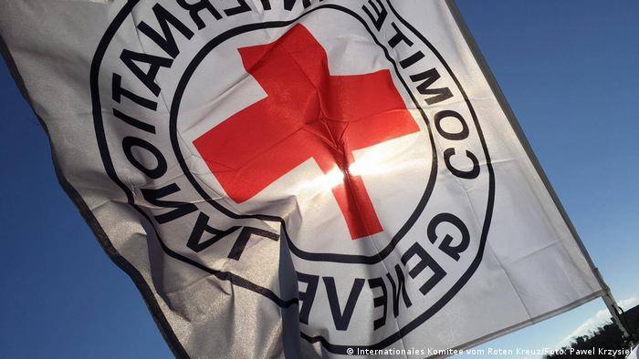 A flag bearing the red cross