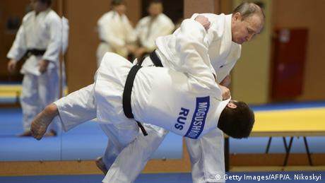 Russian President Vladimir Putin takes part in a judo training session