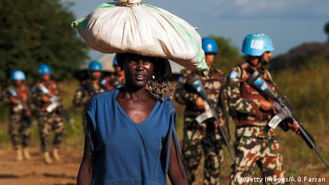 Woman walks past UN soldiers in South Sudan. (Getty Images/A.G.Farran)