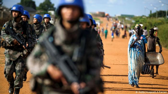 Peacekeeper troops from China deployed by the United Nations Mission in South Sudan (UNMISS), patrol on foot