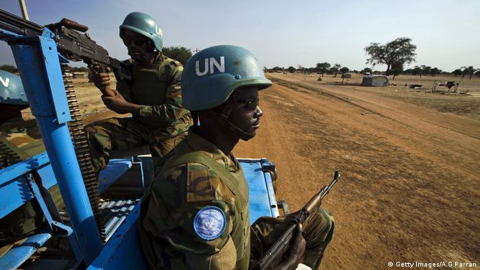 UN peacekeepers on patrol from the back of a car