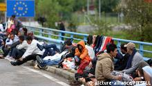 20.09.2015., Harmica, Croatia - The refugees on the border with Slovenia in the cold morning. Those most persistent spent the night on the bridge under a clear sky. Still no buses and the border with Slovenia is closed. Some is provided and medical assistance. Photo: Borna Filic/PIXSELL
