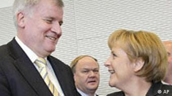 German Agriculture and Consumer Affairs Minister Horst Seehofer with Chancellor Angela Merkel