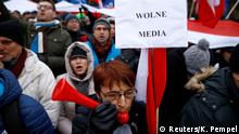 17.12.2016*** Demonstrators gather outside the Parliament building during a protest in Warsaw, Poland, December 17, 2016. The placard reads Free Media!. REUTERS/Kacper Pempel