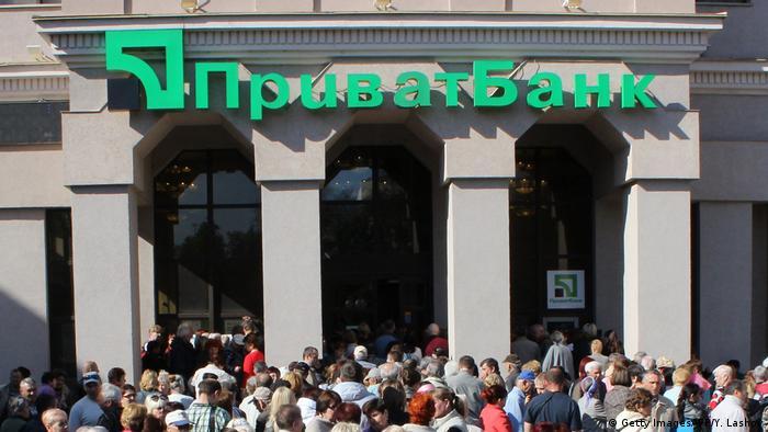 People queue in front of the Ukrainian PrivatBank
