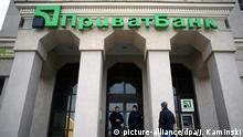epa05682074 (FILE) A file picture dated 17 March 2014 shows guards in front of a closed branch of the largest commercial bank in Ukraine, PrivatBank, in Simferopol, Crimea, Ukraine, 17 March 2014. According to news reports on 19 December 2016, the Ukrainian government has nationalized troubled Privatbank, taking control of the country's largest lender. EPA/JAKUB KAMINSKI POLAND OUT |