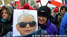 A caricature depicting Jaroslaw Kaczynski, head of leading PIS party as General Wojciech Jaruzelski, who imposed the martial law in Poland in 1981 is seen during an anti-government protest in front of the Constitutional Court to thank the outgoing head of court Andrzej Rzeplinski for his efforts to defend its independence, in Warsaw on December 18, 2016. Polish President Andrzej Duda was holding talks Sunday to try to end a seething political crisis which has seen mass anti-government protests across the country and a parliamentary blockade. / AFP / Janek SKARZYNSKI (Photo credit should read JANEK SKARZYNSKI/AFP/Getty Images)