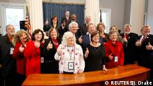 North Carolina's Electoral College representatives give the thumbs up sign after they all affirmed their votes for U.S. President-elect Donald Trump in the State Capitol building in Raleigh, North Carolina, U.S., December 19, 2016. REUTERS/Jonathan Drake