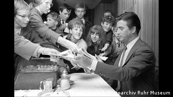 Winnetou actor Pierre Brice is pictured giving autographs to his fans in 1964