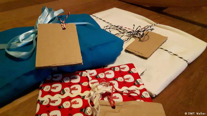Christmas presents wrapped in fabric