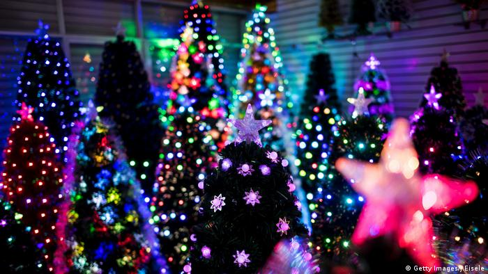 Christmas trees in a display room of Sun Xudan's artificial Christmas tree factory in Yiwu